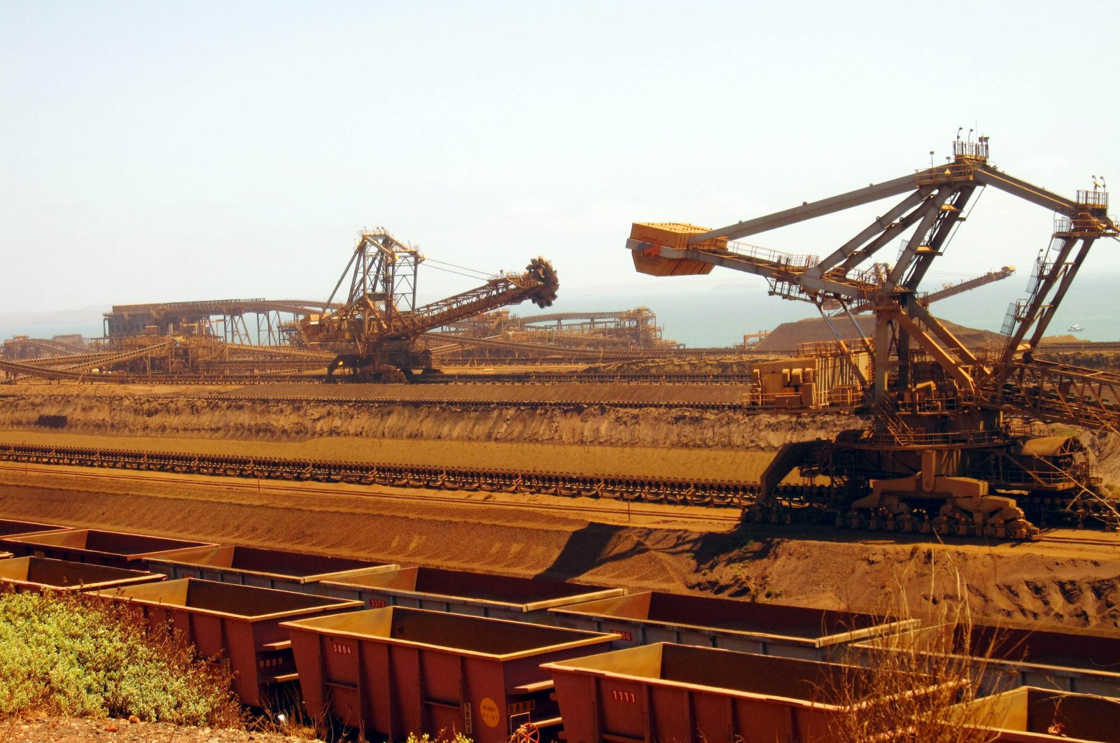 This file photo shows remote-controlled stackers and reclaimers moving iron ore to rail cars at Rio Tinto's Port Dampier operations in Western Australia's Pilbara region, March 4, 2010. (AFP Photo)