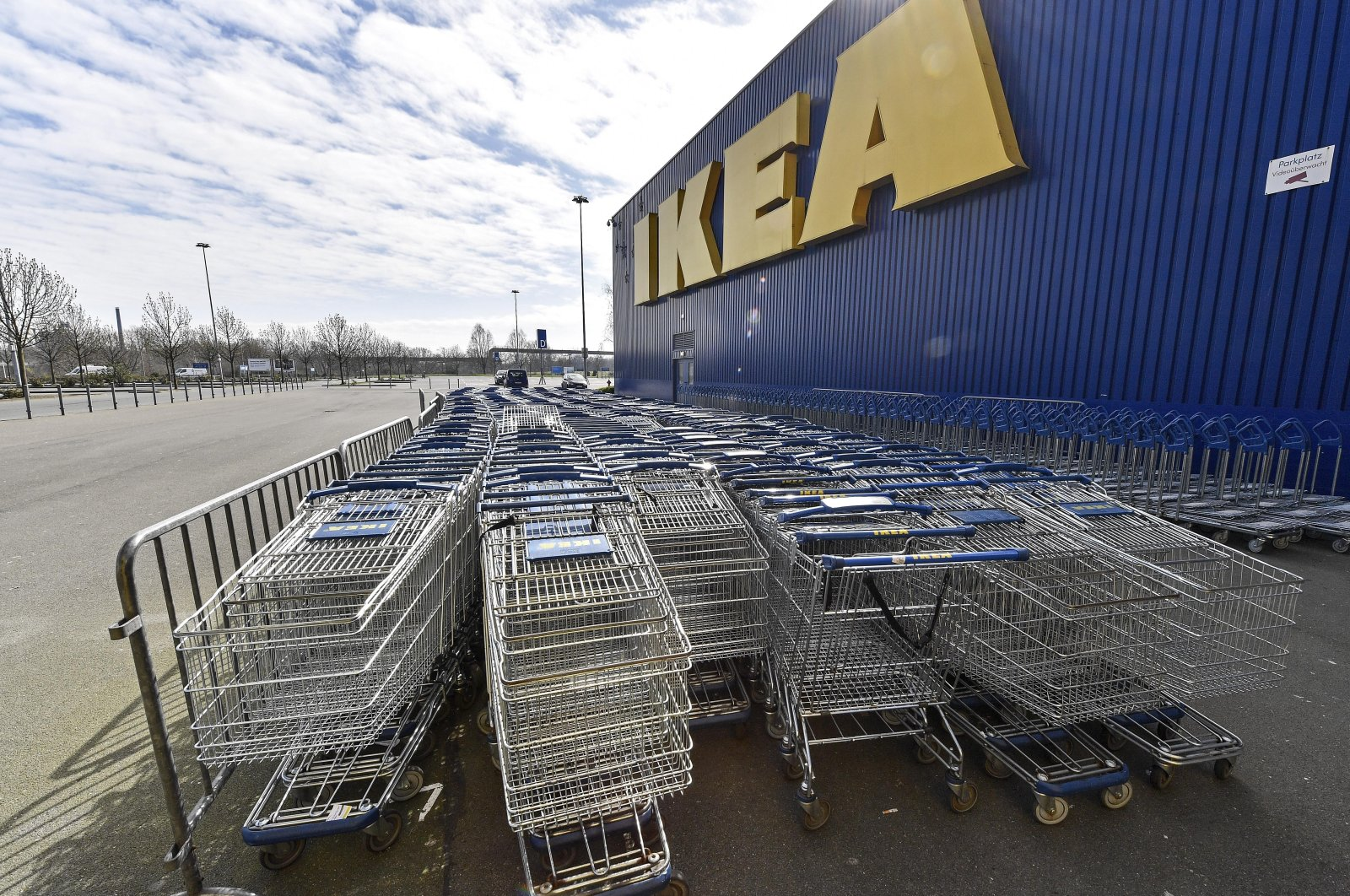 Empty trolleys are stored in front of an IKEA store in Duisburg, Germany, March 19, 2020. (AP Photo)