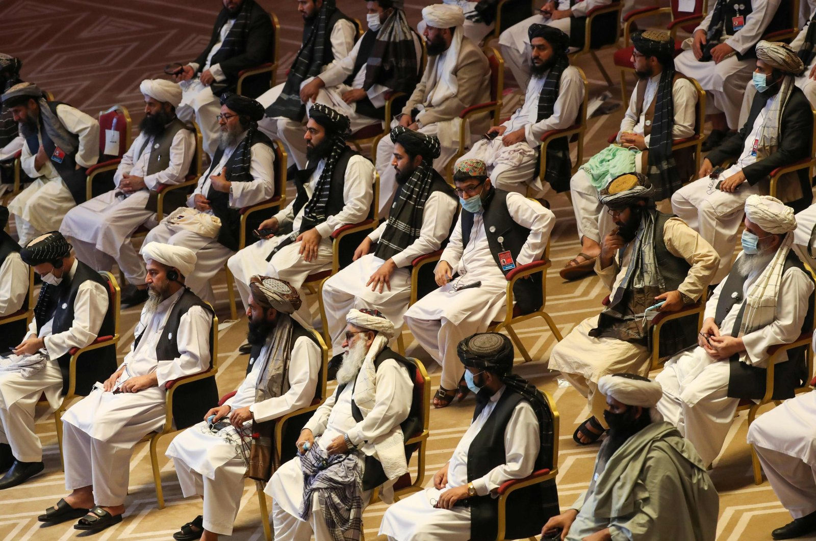 Members of the Taliban delegation attend the opening session of the peace talks between the Afghan government and the Taliban in Doha, Qatar, Sept. 12, 2020. (AFP Photo)