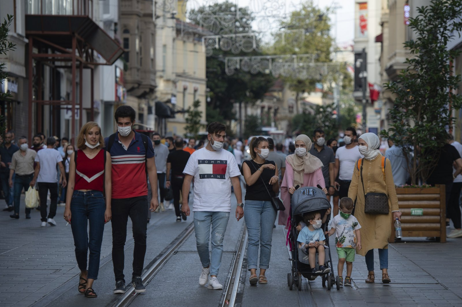 People wearing masks for protection against the spread of coronavirus, walk along Istiklal street, the main shopping street in Istanbul, Friday, Sept. 11, 2020. (AP Photo)