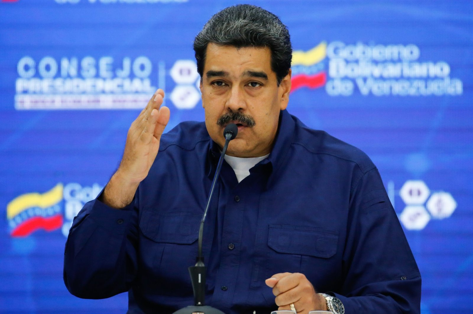 A handout picture released by the Venezuelan presidency showing Venezuelan President Nicolas Maduro talking during a meeting with ministers in Caracas on February 18, 2019