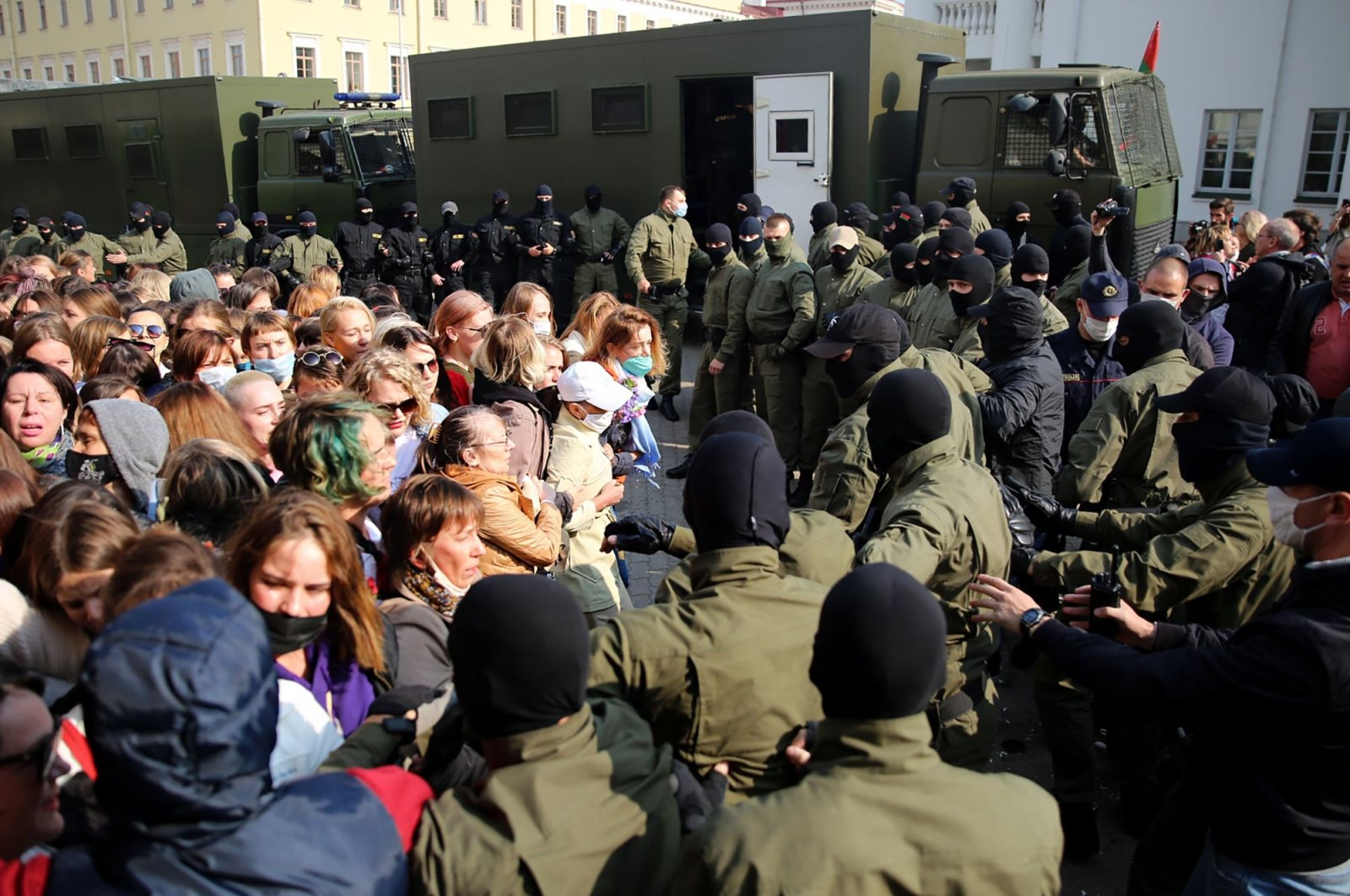 Riot police officers surround women during a rally to protest against the presidential election results in Minsk on Sept. 12, 2020. (AFP Photo)