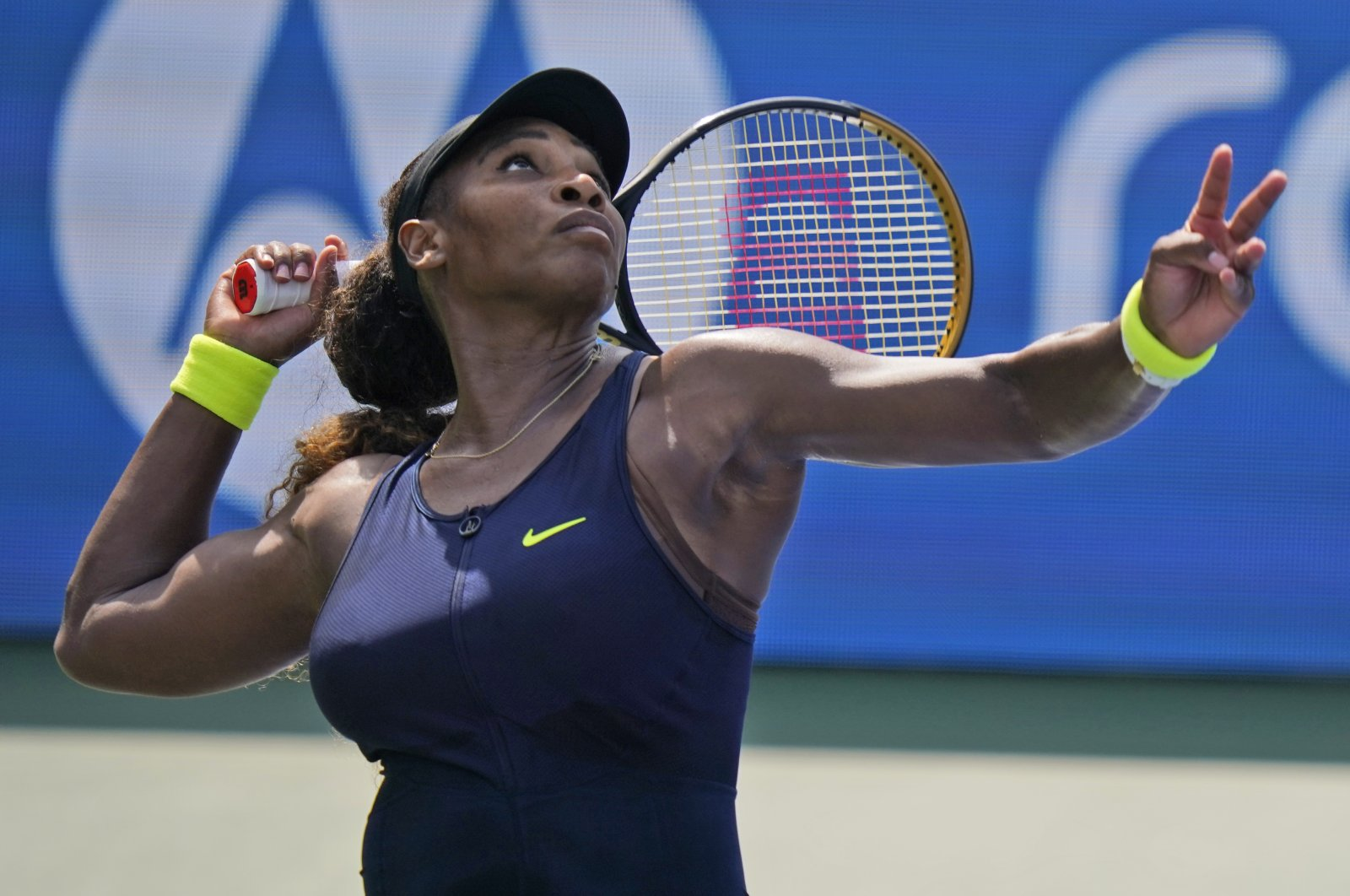 Serena Williams serves to Arantxa Rus, of the Netherlands, during the second round at the Western & Southern Open tennis tournament in New York, Aug. 24, 2020. (AP Photo)
