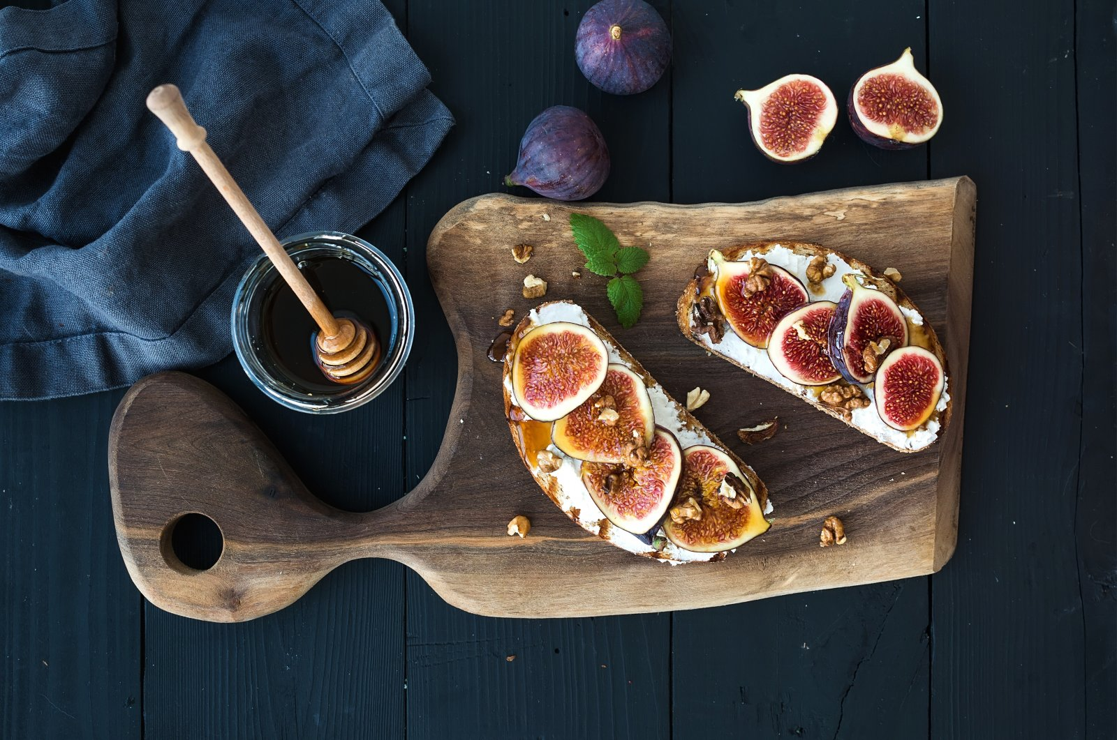 Ricotta, fresh figs, walnuts and honey go well on some homemade sourdough bread. (iStock Photo)