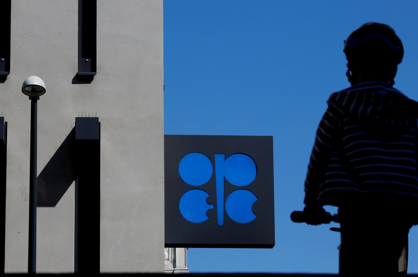 A person passes the logo of the Organization of the Petroleum Exporting Countries (OPEC) in front of its headquarters in Vienna, Austria on April 9, 2020. (Reuters Photo)