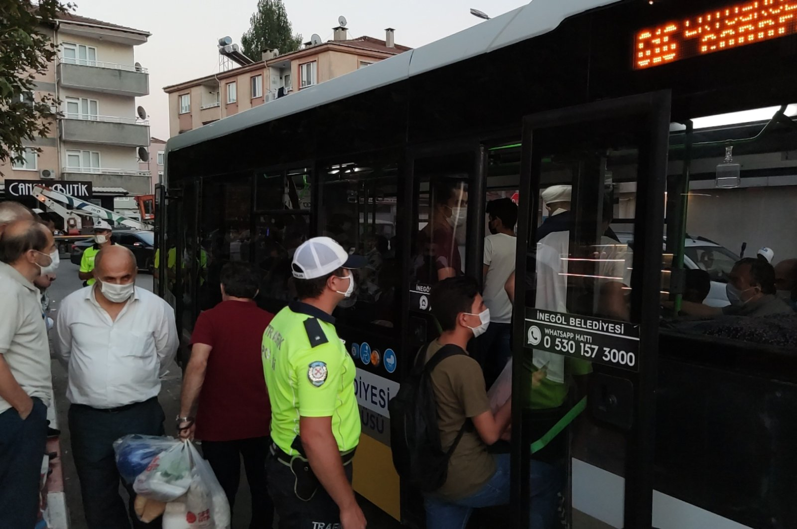 A police officer inspects for compliance with public transport rules in İnegöl district of Bursa, western Turkey, Sept. 11, 2020. (DHA Photo)
