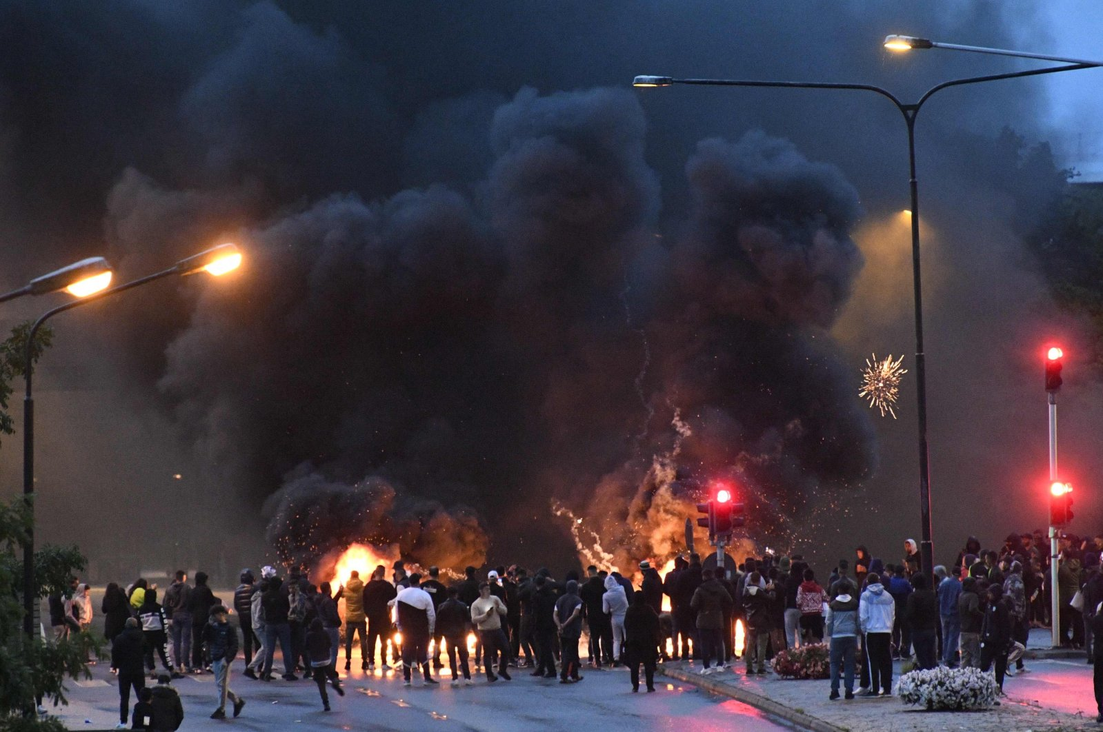 Smoke billows from burning tyres, pallets and fireworks as a few hundred protesters riot, which was sparked by the burning of a Quran, in the Rosengard neighborhood of Malmo, Sweden, Aug. 28, 2020. (AFP)