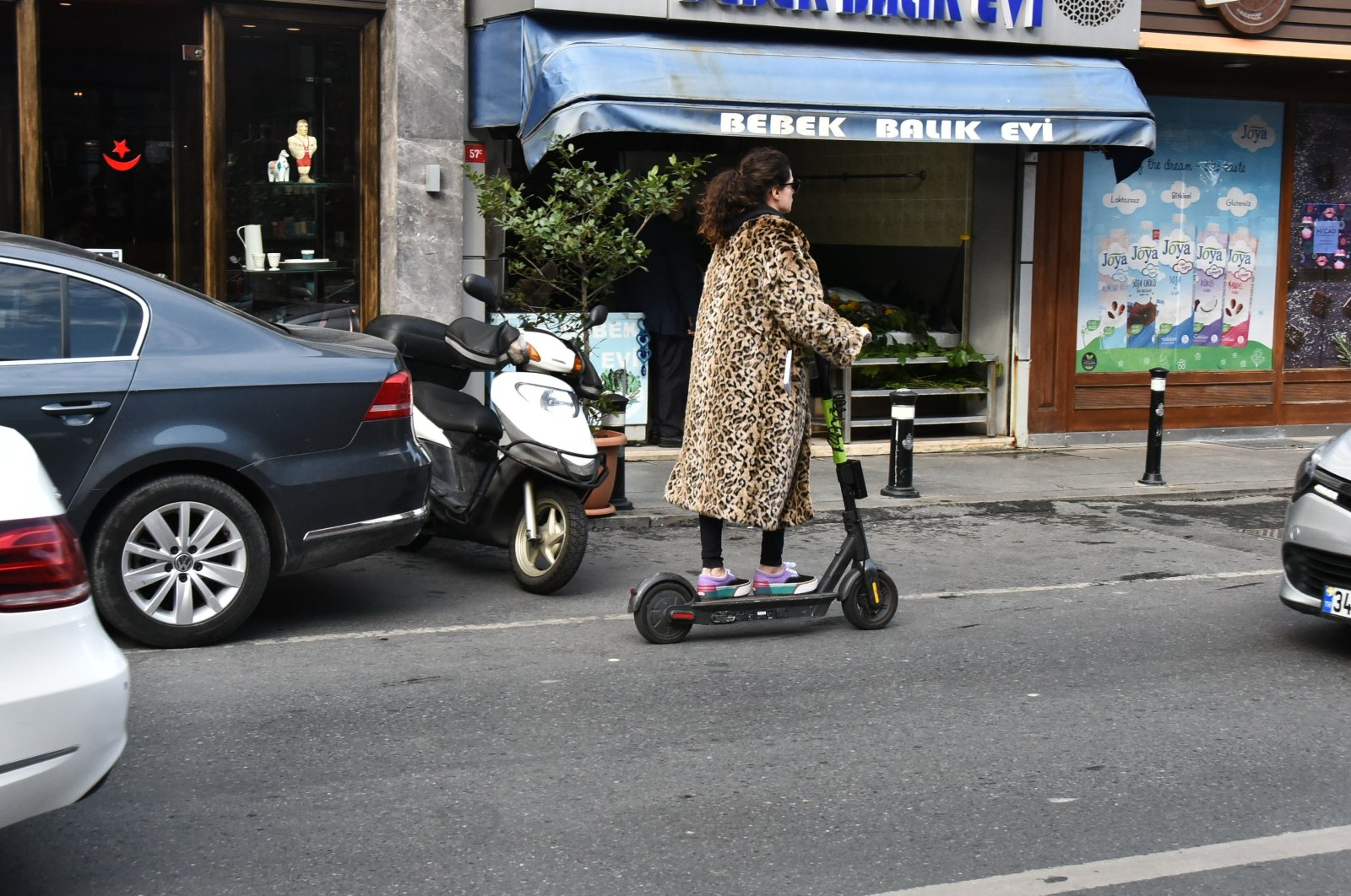 A woman rides an e-scooter in Istanbul, Turkey, Nov. 30, 2019. (Photo by Ali Keser)
