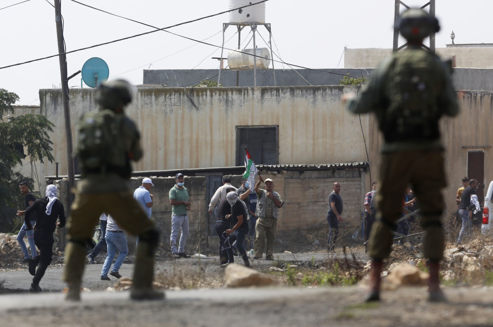 Israeli troops clash with the Palestinian demonstrators following a weekly demonstration against Israeli Jewish settlements, in the West Bank, Sept. 4, 2020. (AP Photo)