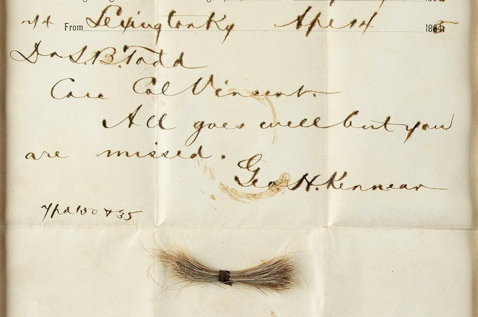 A bloodstained telegram and lock of hair from former U.S. President Abraham Lincoln, to be auctioned Sept. 12, Washington, D.C., July 2020. (Nikki Brickett/RR Auction via AP)