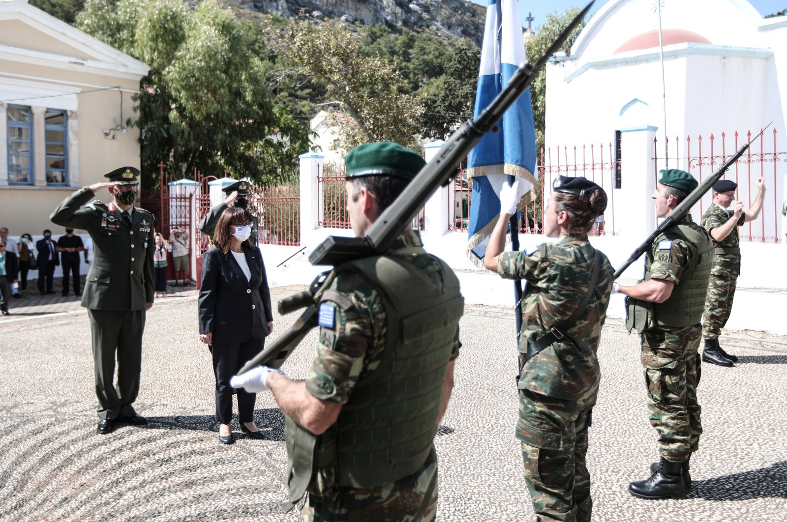 Greek President Katerina Sakellaropoulou inspects a guard of honor during a visit to the island of Kastellorizo, Greece, Sept. 13, 2020. (Reuters Photo)