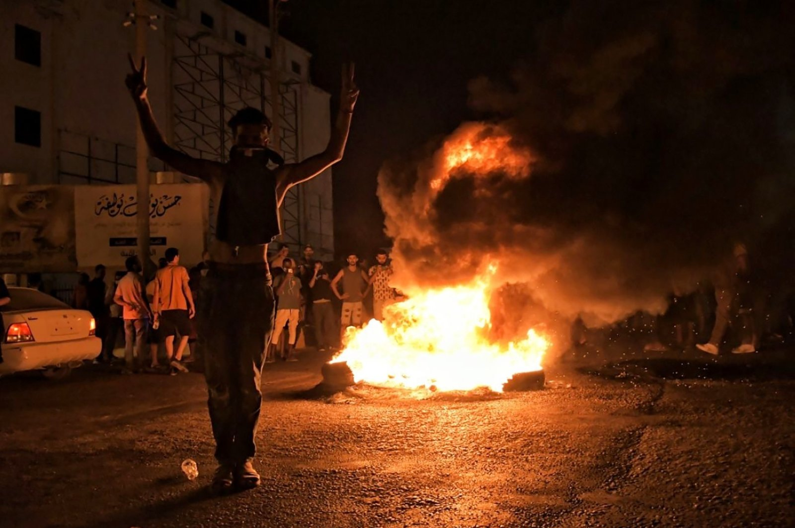 Protesters angry over the area's crippling electricity shortages set fire to tires on Thursday, Sept. 10, 2020 in Benghazi, Libya. (AP Photo)