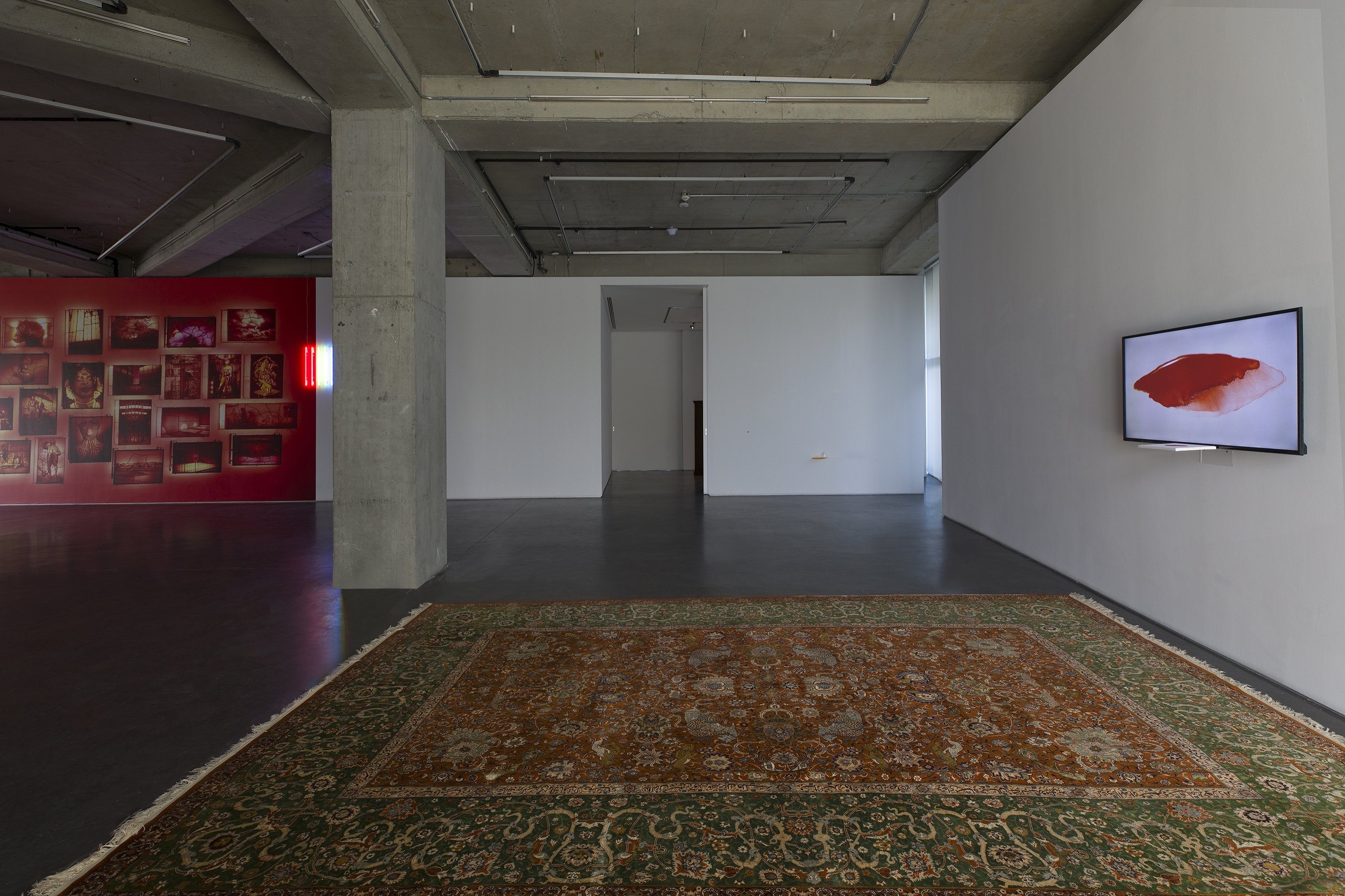 The Persian rug in the front of an original painting by Sarkis, which is enlarged as a video, at Dirimart Gallery, Istanbul. (Courtesy of Dirimart)