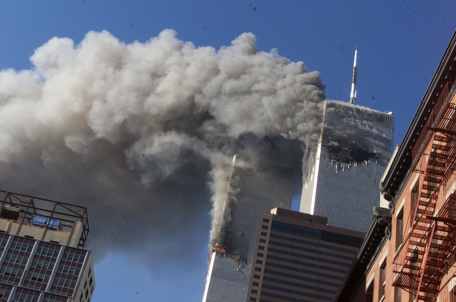 Smoke rises from the burning twin towers of the World Trade Center after hijacked planes crashed into the towers, in New York City, Sept. 11, 2001. (AP Photo)
