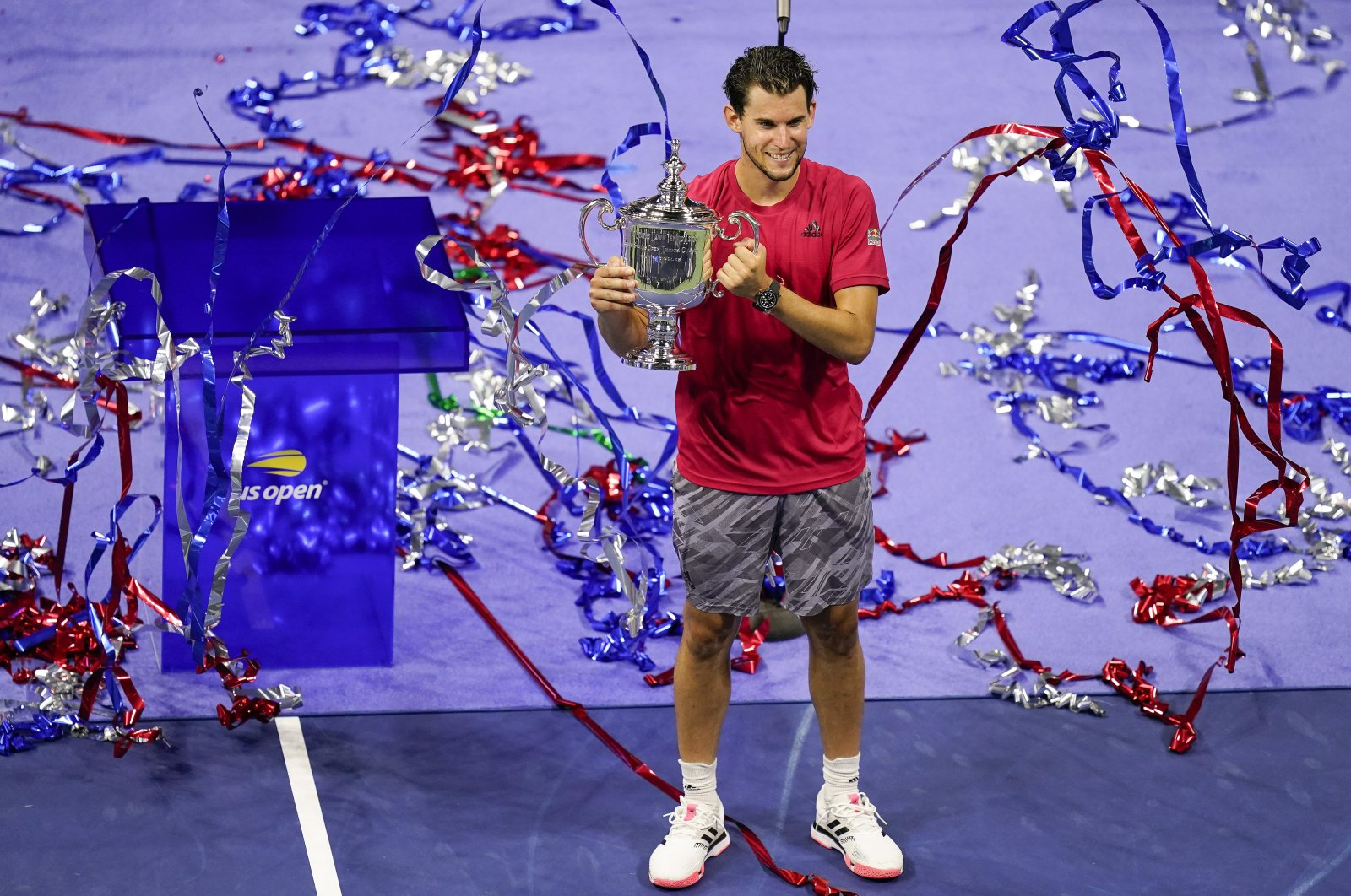 Confetti falls as Dominic Thiem holds up the championship trophy, in New York, United States, Sept. 13, 2020. (AP Photo)