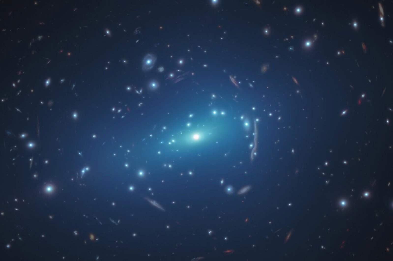 An undated NASA/ESA Hubble Space Telescope image shows the massive galaxy cluster MACSJ 1206. (Observatory of Astrophysics and Space Science of Bologna), P. Natarajan (Yale University)/The CLASH team and M. Kornmesser/ESA/Hubble/Handout via REUTERS)