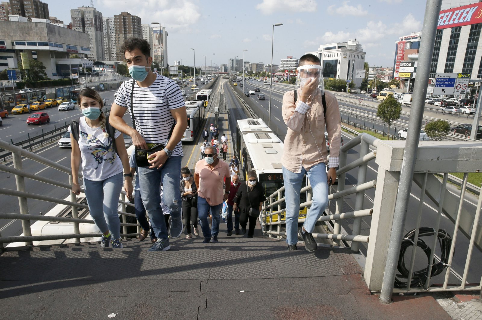 People wearing protective masks leave a metrobus stop in Istanbul, Turkey, Sept. 14, 2020. (AA Photo)