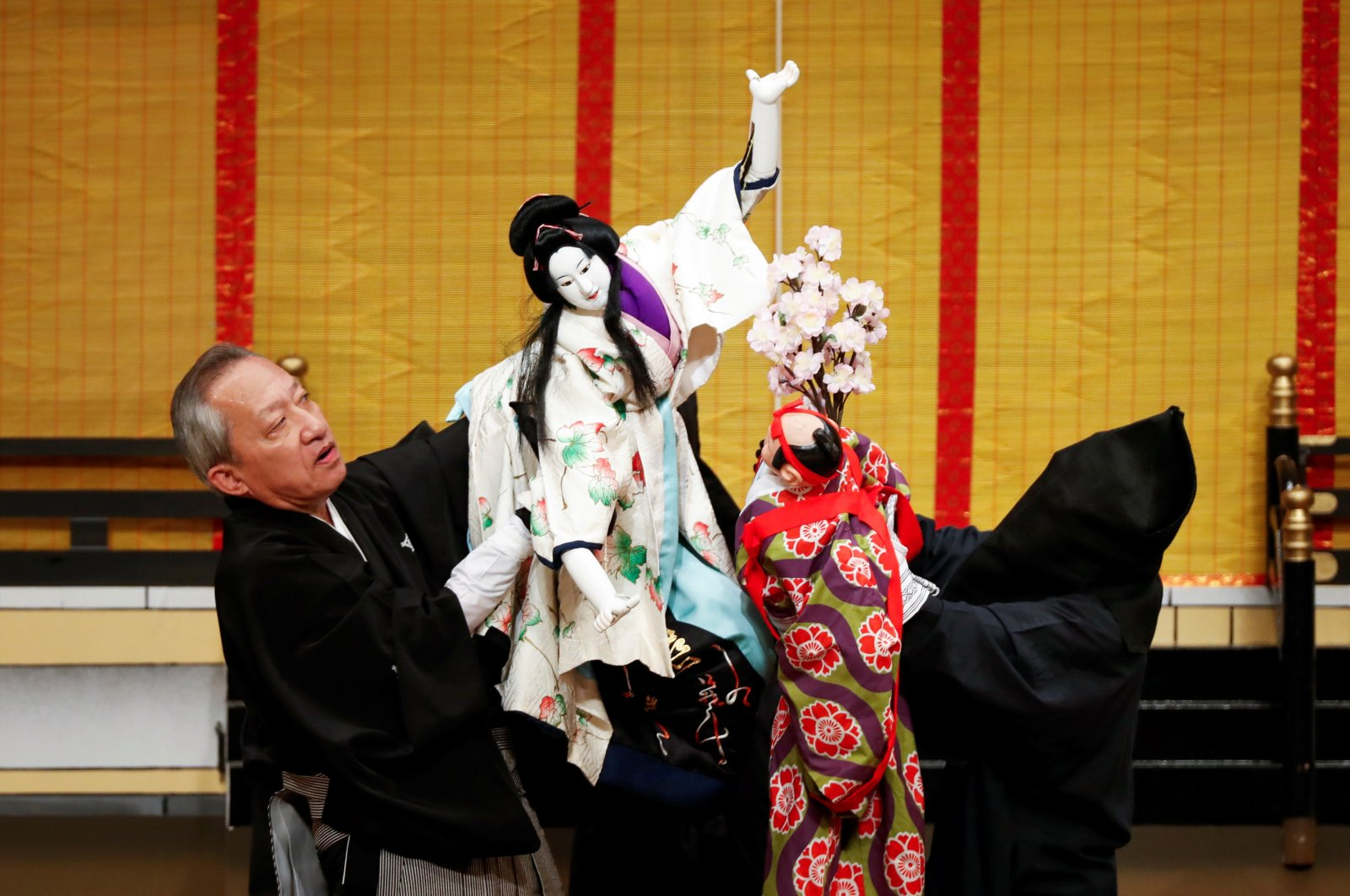 "Bunraku puppeteer Kanjuro Kiritake, who was designated a Living National Treasure by the Japanese government, performs Bunraku during a program titled ""Komochi Yamanba"" (""The Pregnant Mountain Ogress"") at the National Theatre in Tokyo, Japan, Sept.7, 2020. (REUTERS PHOTO)"