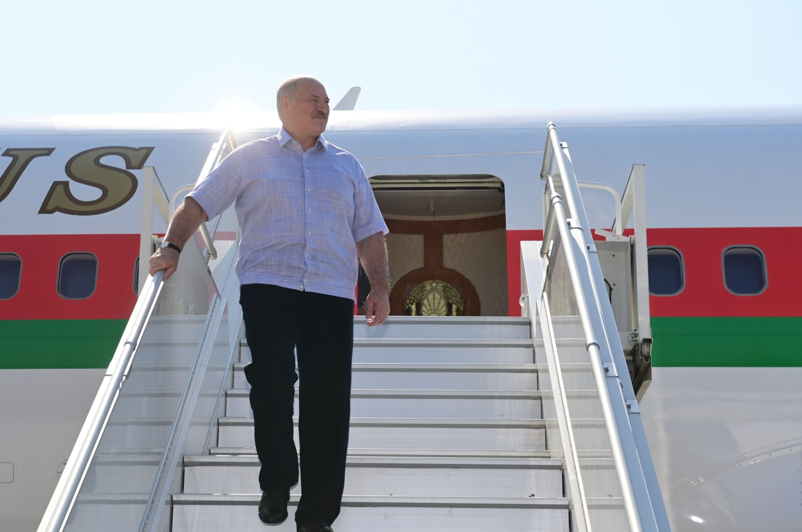 Belarus' President Alexander Lukashenko disembarks from a plane as he arrives at an airport, Sochi, Sept. 14, 2020. (AFP Photo)