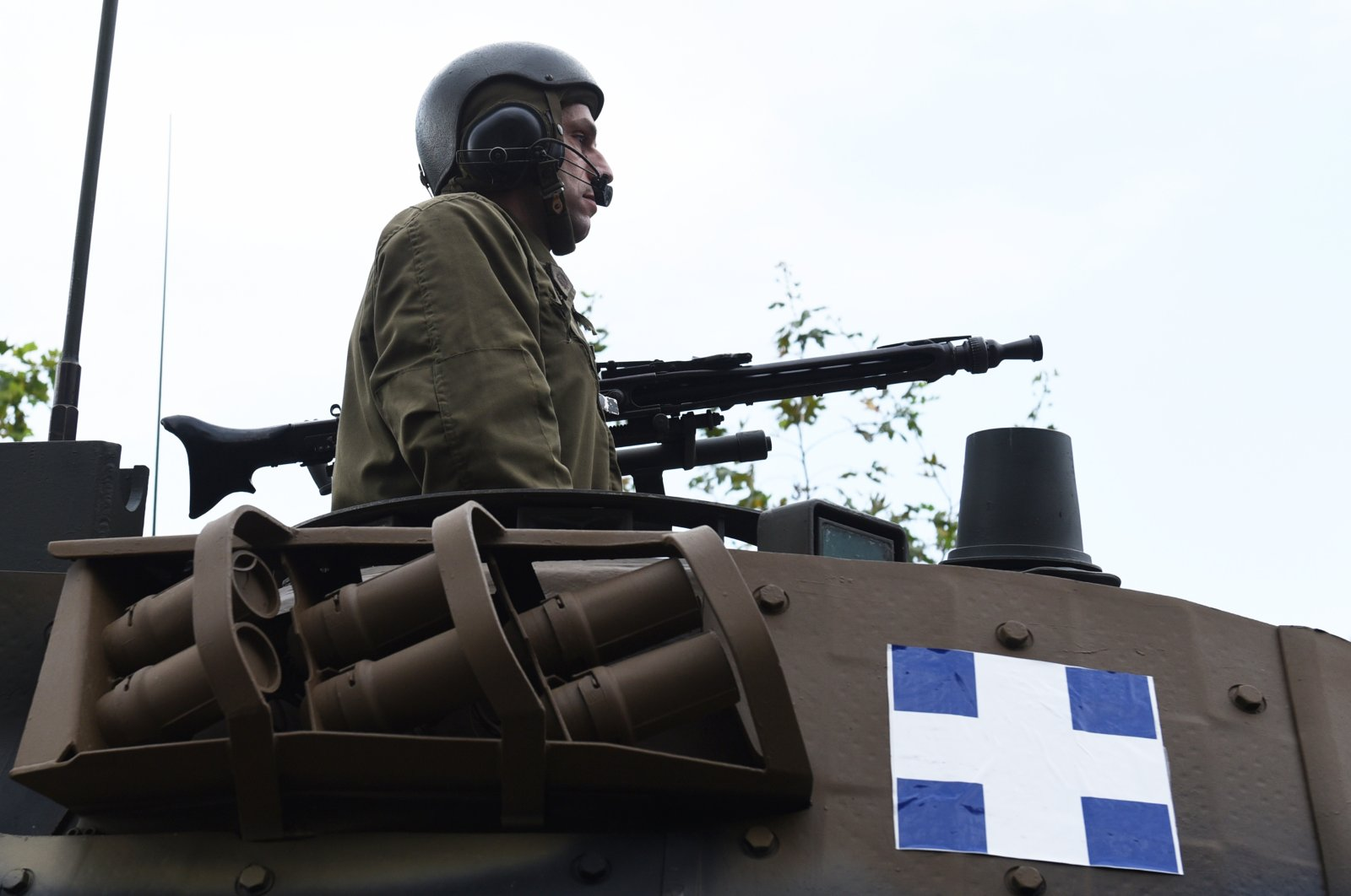 In this Oct. 28, 2015 file photo, a gunner atop a tank parades through the streets of the northern port city of Thessaloniki, Greece during a military parade. (AP File Photo)