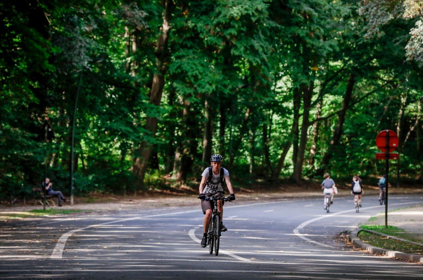 A man rides a bike in the Bois de La Cambre in Brussels, Belgium, Sept. 7, 2020. (EPA Photo)