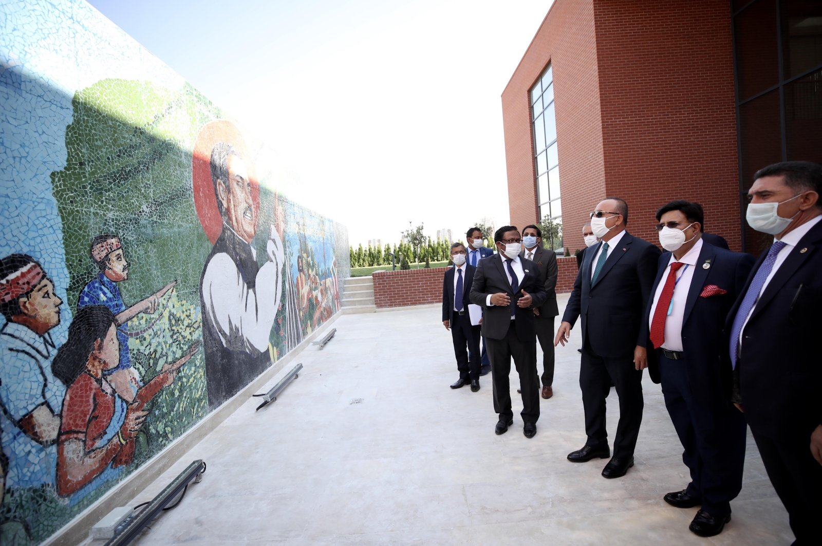 Foreign Minister Mevlüt Çavuşoğlu and his Bangladeshi counterpart A.K. Abdul Momen tour the newly established embassy of Bangladesh in Ankara, Turkey, following the inauguration ceremony, Sept. 14, 2020. (AA Photo)