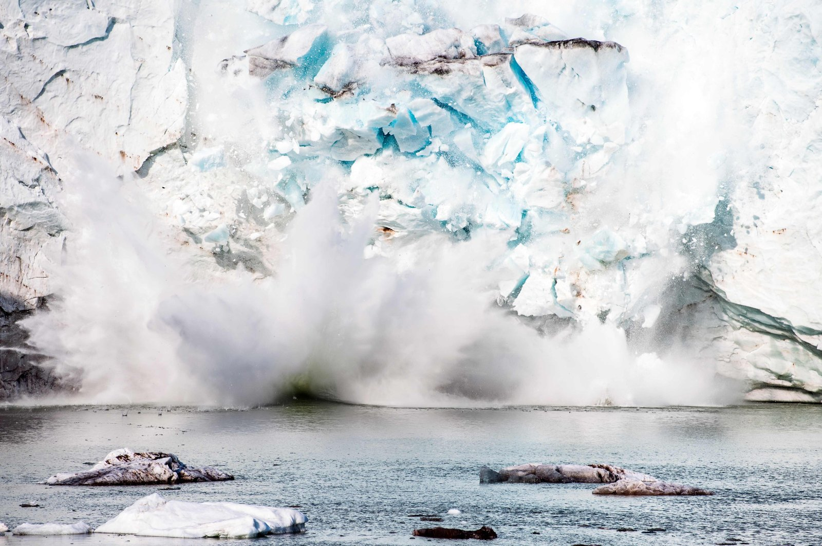 This file photo shows an iceberg calving with a mass of ice breaking away from the Apusiajik glacier, near Kulusuk, a settlement in the Sermersooq municipality located on the island of the same name on the southeastern shore of Greenland, Aug. 17, 2019. (AFP Photo)
