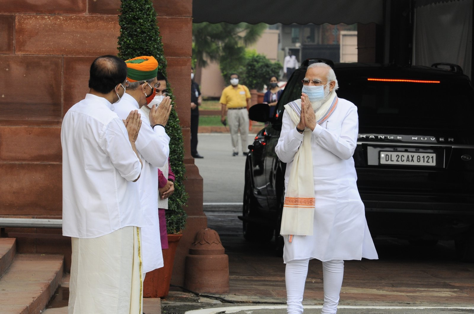 Indian Prime Minister Narendra Modi (R) is received by his ministerial colleagues as he arrives at the parliament in New Delhi, India, Sept. 14, 2020. (AP Photo)