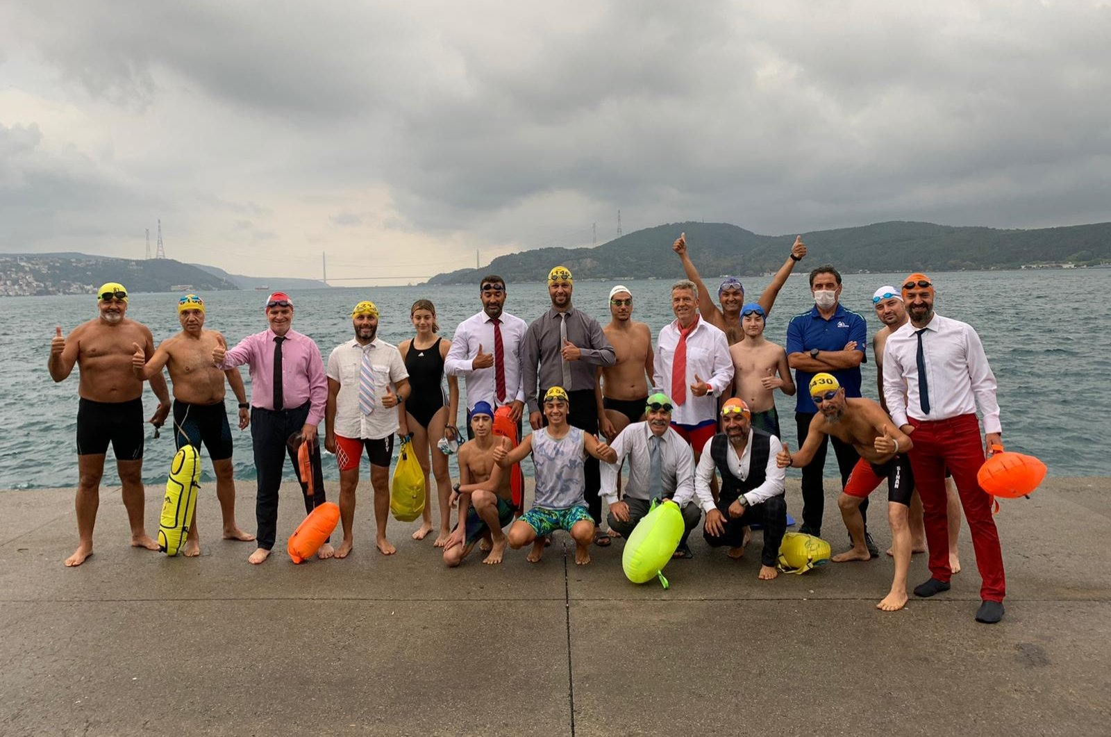 """The """"Masters of Bosporus"""" swimming group poses for a photo before their swim in the Bosporus, Istanbul, Turkey, Sept. 13, 2020. (DHA Photo)"""