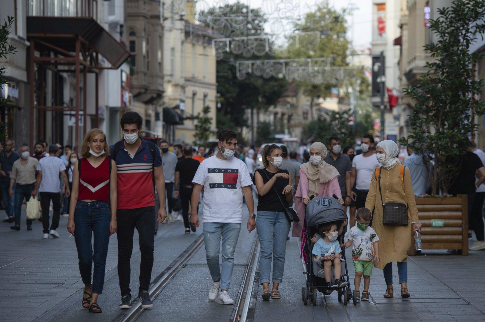People wearing face masks walk along Istiklal Avenue in Istanbul, Turkey, Sept. 11, 2020. (AP Photo)