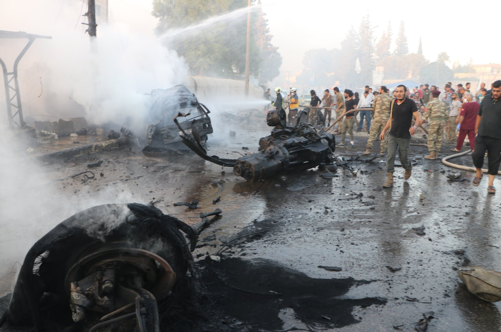 The scene of a deadly vehicle bombing carried out by YPG/PKK terrorists in Afrin, northwestern Syria, Sept. 14, 2020. (AA Photo)