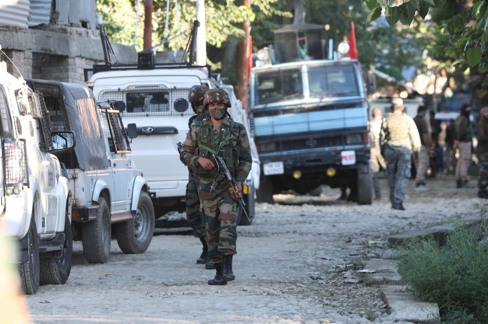 Indian security personnel stand guard near the site of a gunfight in a village in the Kawoosa area of central Kashmir's Budgam district, some 20 kilometers from Srinagar, the summer capital of Indian Kashmir, Sept. 7, 2020. (EPA Photo)