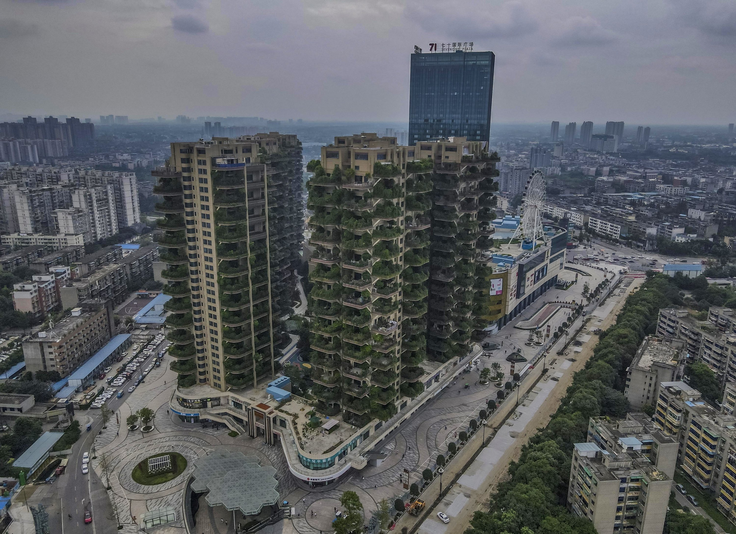 A photo taken with a drone shows an aerial view of Qiyi City Forest Garden residential buildings complex in Chengdu, China, Sept. 15, 2020. (EPA Photo)