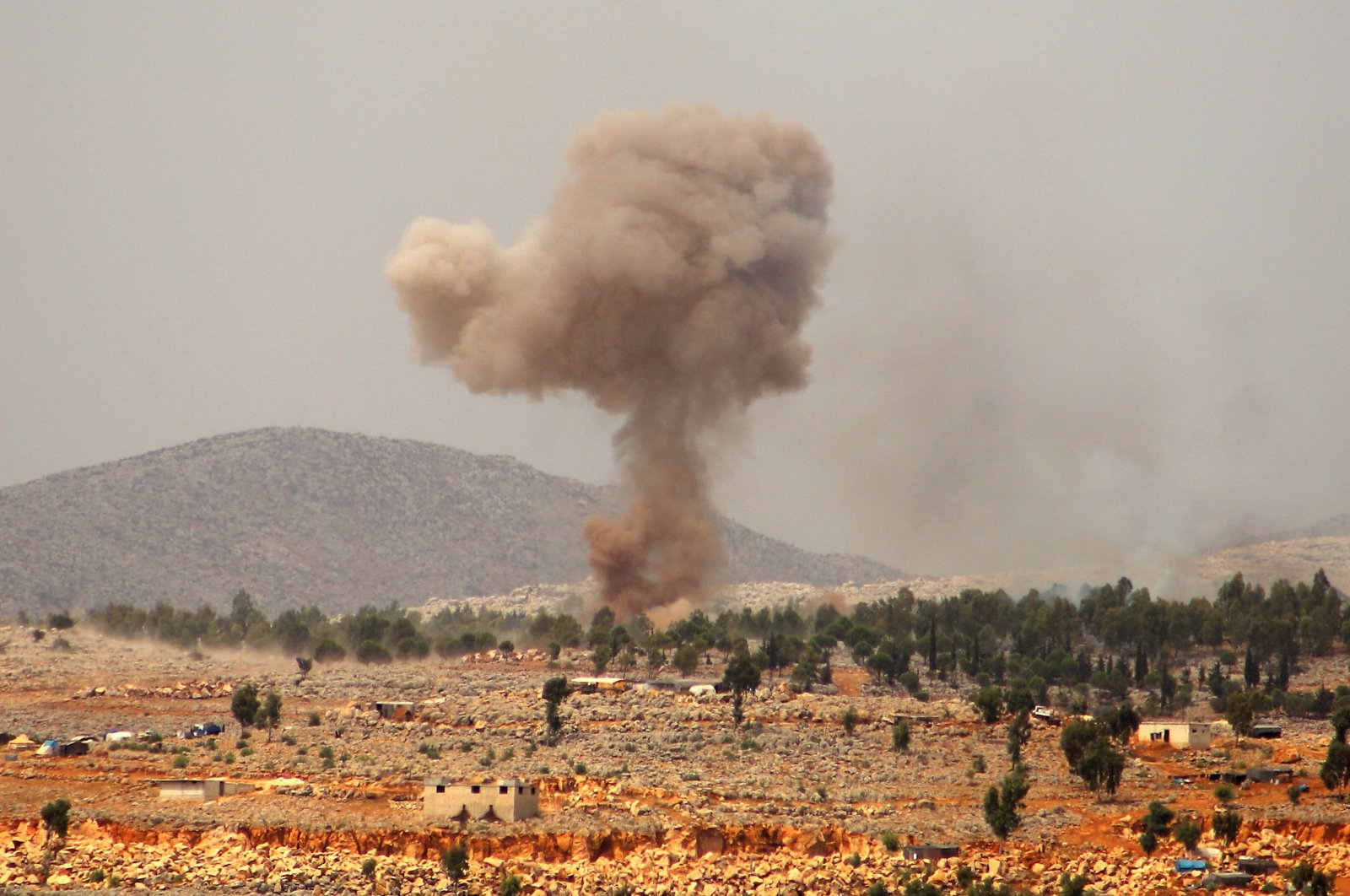 Smoke billows from a reported Russian airstrike near the village of Hafsarjah, in the western countryside of Idlib province in northwestern Syria, Sept. 11, 2020. (AFP Photo)