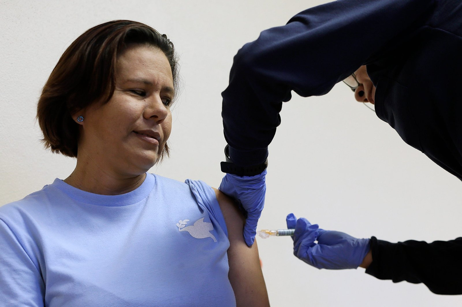 A woman gets her free influenza vaccine from El Paso Fire Department Paramedic Elvira Prieto on Aug. 1, 2020. (REUTERS Photo)