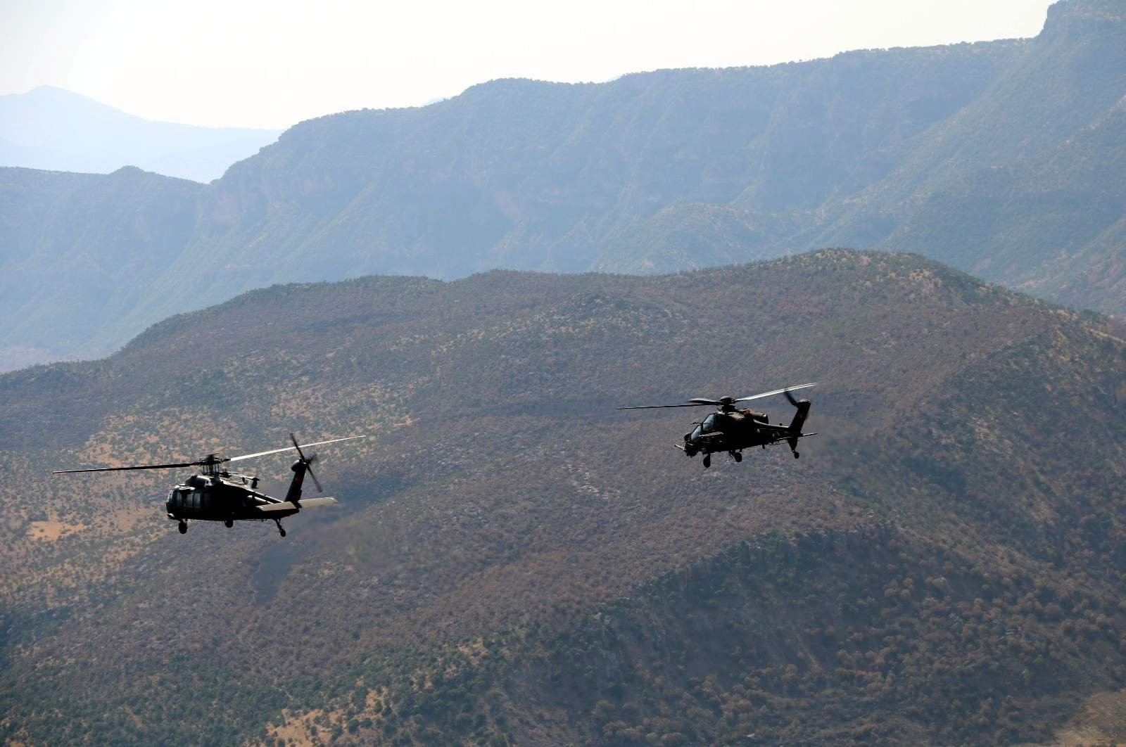 Two Turkish military helicopters take part in a counterterrorism operation against the PKK in southeastern Turkey's Siirt, Sept. 15, 2020. (DHA Photo)