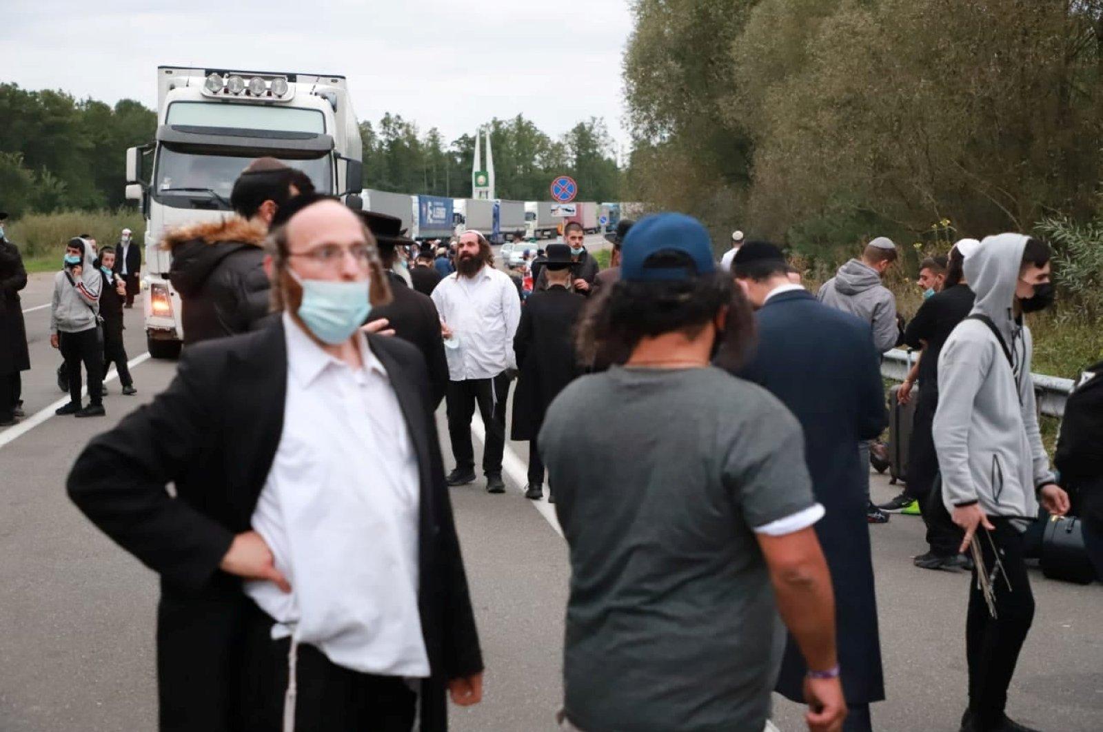 Jewish pilgrims, who plan to enter Ukraine from the territory of Belarus, gather at Novi Yarylovychi crossing point in Chernihiv Region, Ukraine Sept. 14, 2020. (State Border Guard Service of Ukraine via Reuters)