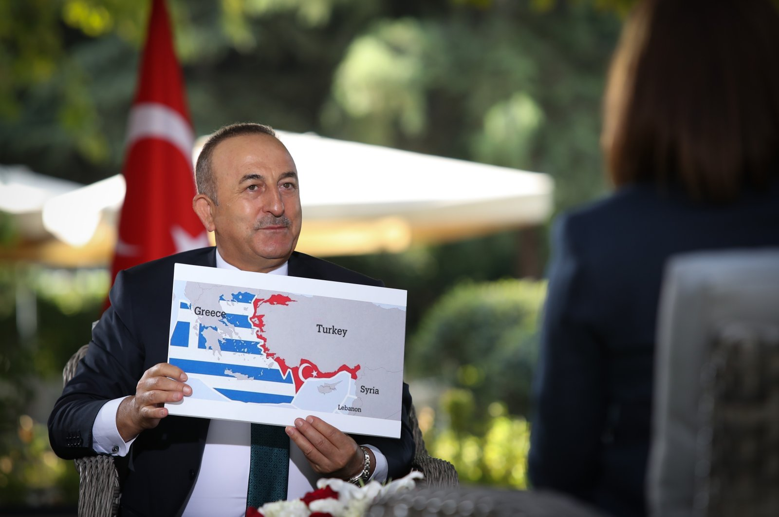 Turkish Foreign Minister Mevlüt Çavuşoğlu speaks on tensions in the Eastern Mediterranean during a televised interview with NTV, Sept. 14, 2020. (AA Photo)