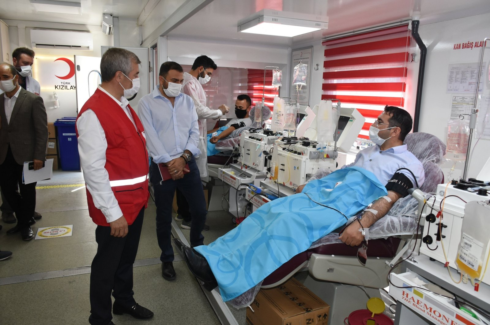 Two men donate plasma at a Turkish Red Crescent center in Gaziantep, southern Turkey, Sept. 11, 2020. (İHA Photo)