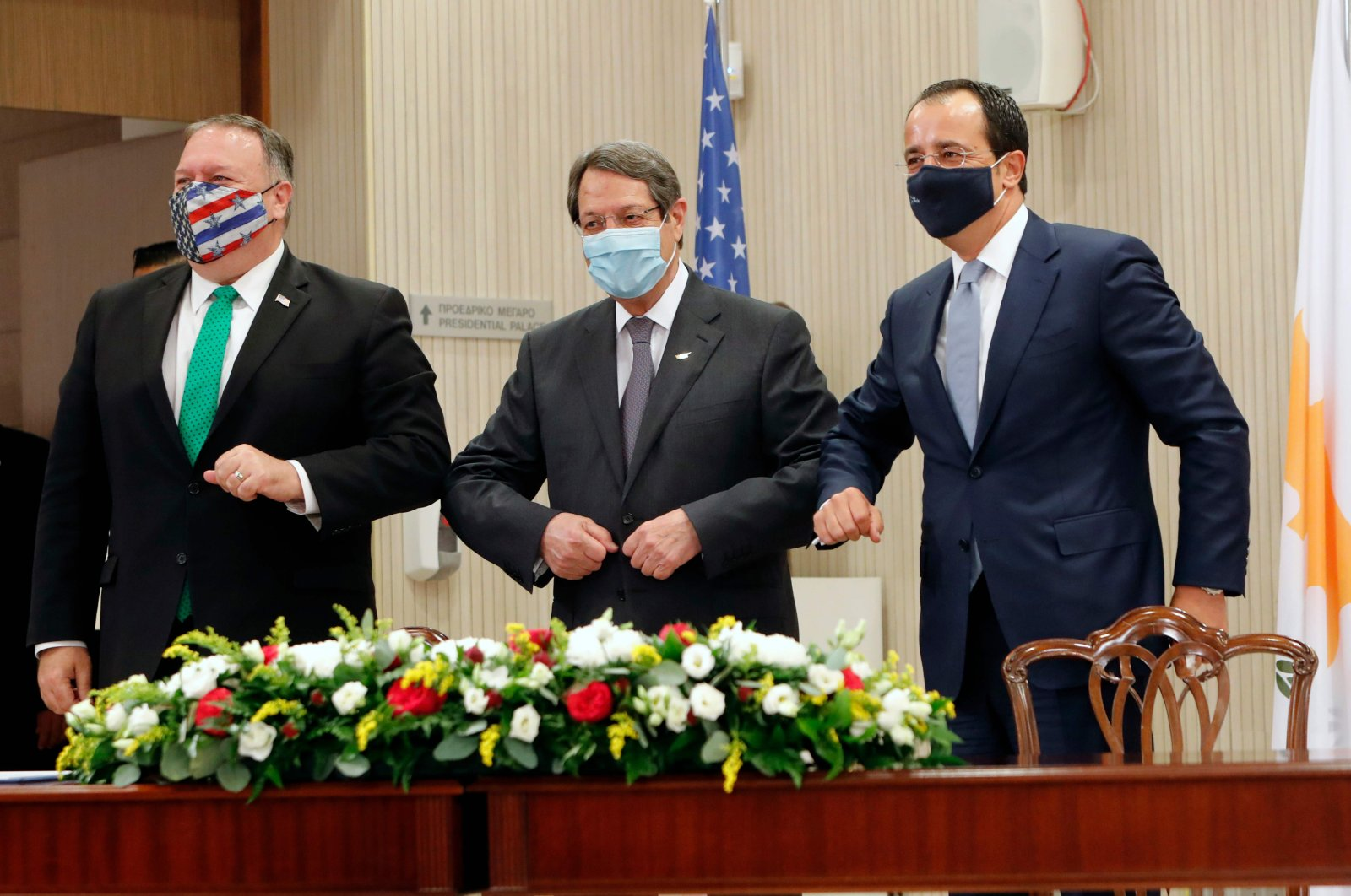U.S. Secretary of State Mike Pompeo (L), Greek Cypriot leader Nicos Anastasiades (C), and Greek Cypriot foreign minister Nikos Christodoulides (R) touch elbows as they meet at the presidential palace in the capital Nicosia, Greek Cyprus, Sept. 12, 2020. (AFP Photo)