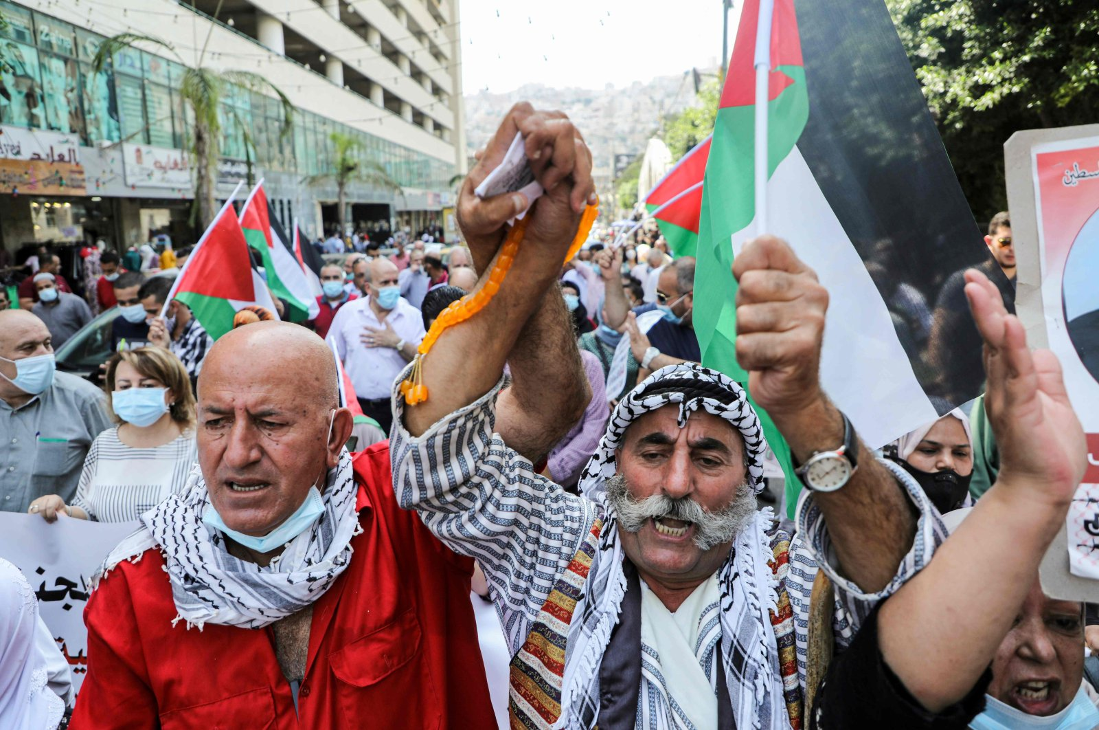 Demonstrators take to the streets with Palestinian flags during a protest in the city of Nablus, the occupied West Bank, Sept. 15, 2020. (AFP Photo)