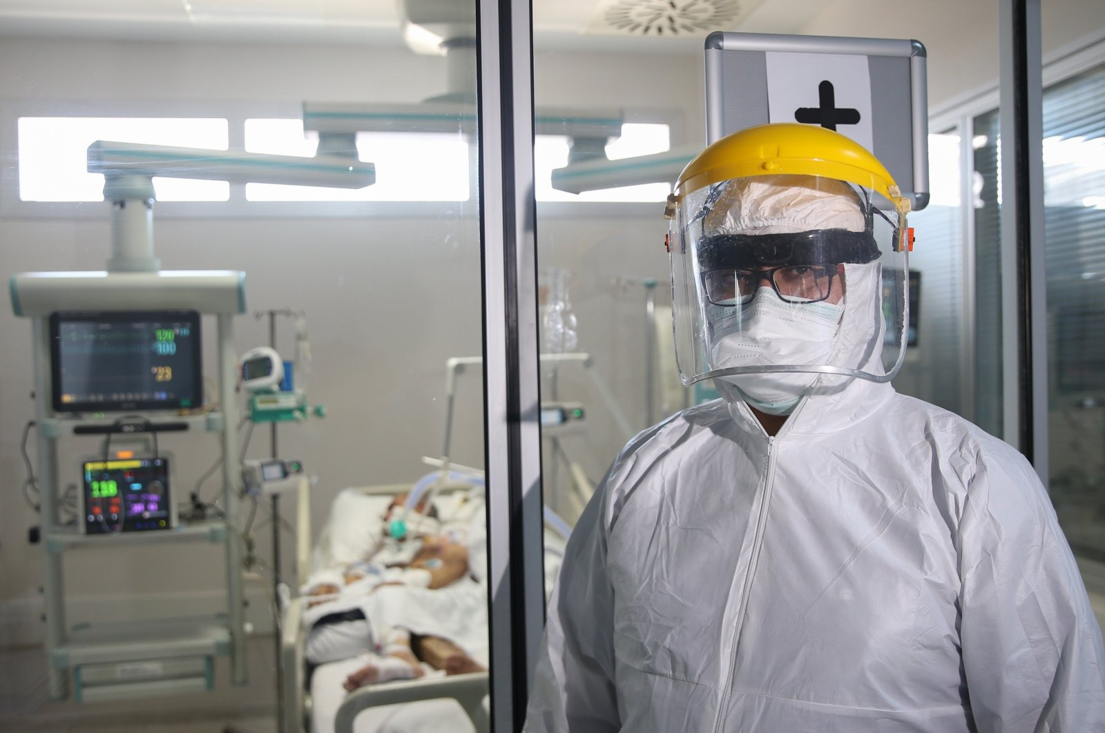 Murat Yılmaz wearing protective gear stands at the entrance to an intensive care unit at the Akdeniz University Hospital in Antalya, southern Turkey, Sept. 15, 2020. (AA Photo)
