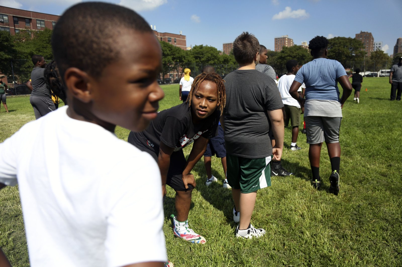 Children warm up with teammates at the first football practice of the season on Sunday, Aug. 9, 2020, in Brooklyn borough of New York. (AP Photo)