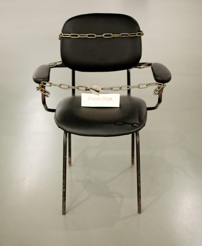 Füsun Onur's 'Untitled,' installation, chair, chain, name tag, 1993-2012.