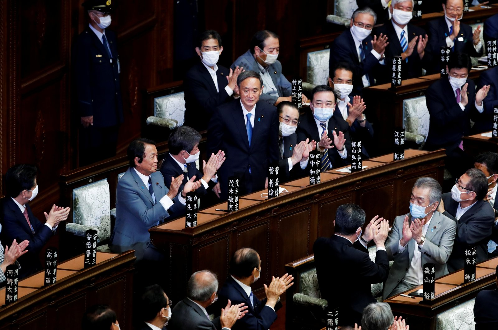 Japan's newly elected Prime Minister Yoshihide Suga stands in the lower house of parliament in Tokyo, Japan, Sept. 16, 2020. (Reuters Photo)