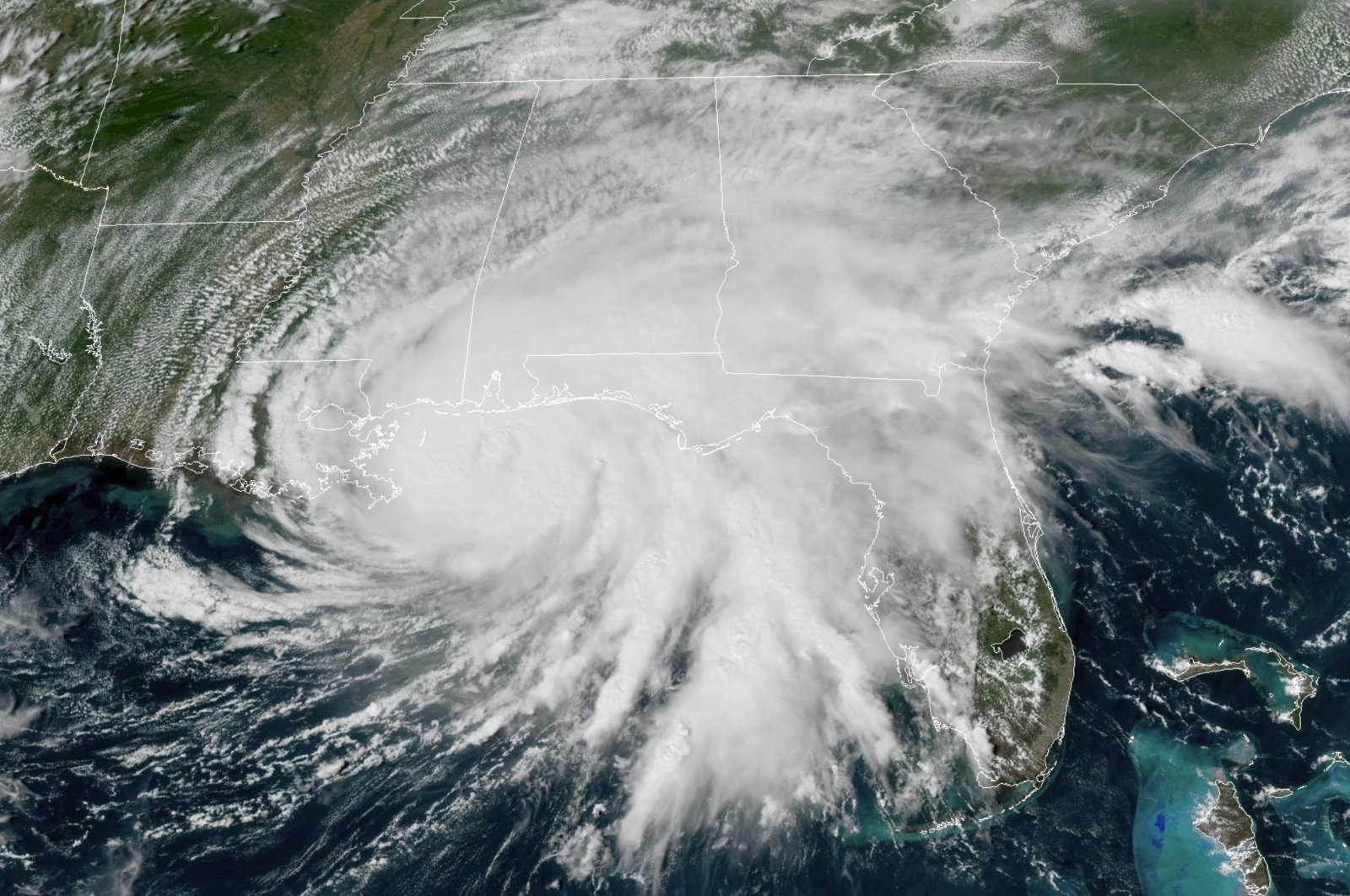 This GOES-16 GeoColor satellite image, provided by NOAA, shows Hurricane Sally moving slowly toward the coast from the Gulf of Mexico, at 3 p.m. EDT, Sept. 15, 2020. (AP Photo)