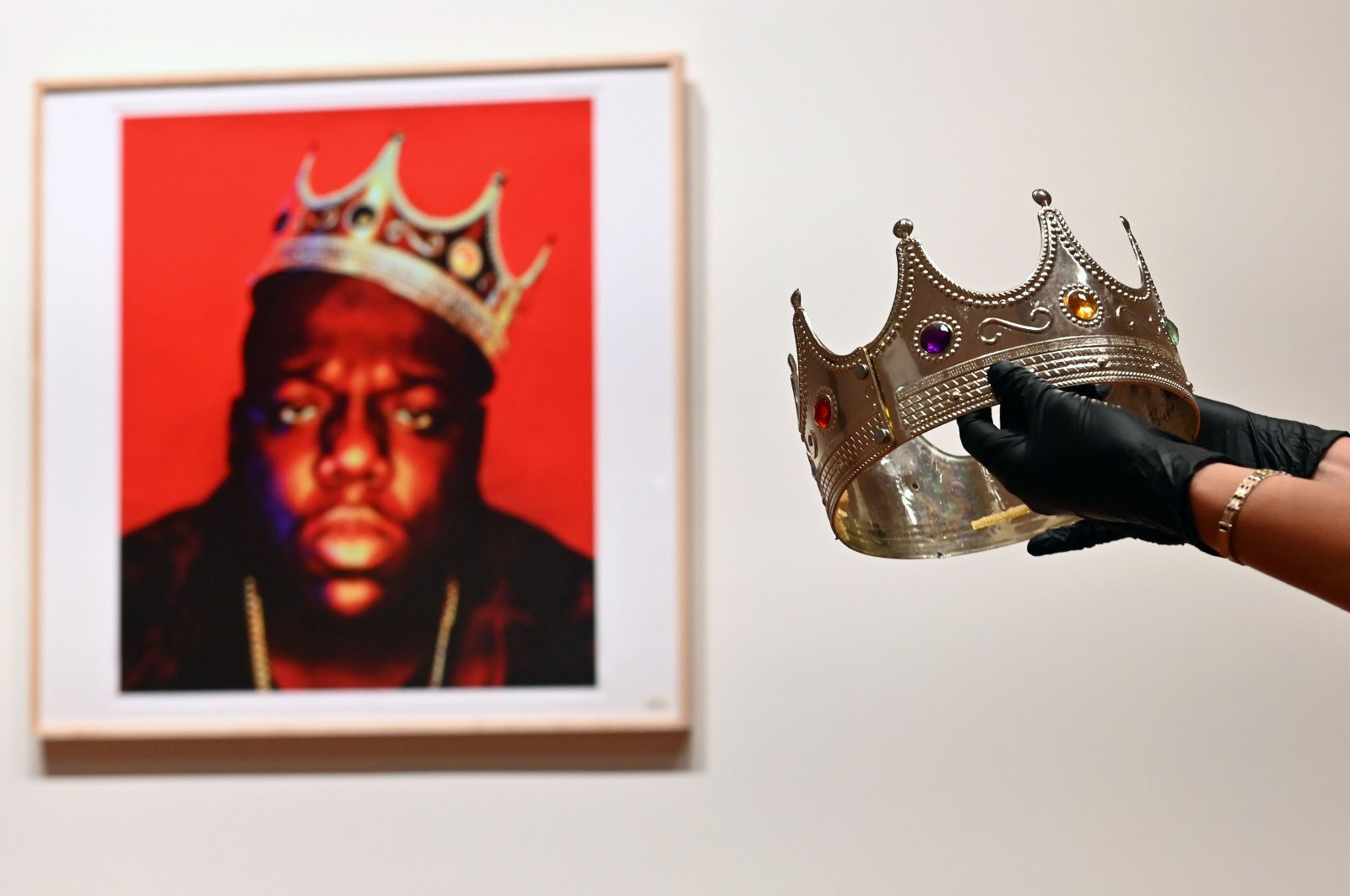 The crown worn by Notorious B.I.G. when photographed as the King of New York, is displayed during a press preview at Sotheby's for their inaugural HIP HOP Auction on Sept. 10, 2020 in New York City. (AFP PHOTO)
