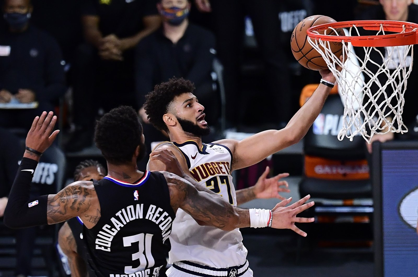 Denver Nuggets' Jamal Murray (R) drives to the basket against LA Clippers' Marcus Morris during an NBA game in Lake Buena Vista, Florida, U.S., Sept. 15, 2020. (AFP Photo) == FOR NEWSPAPERS, INTERNET, TELCOS & TELEVISION USE ONLY ==