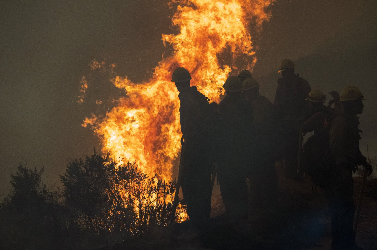 Firefighters monitor a controlled burn along Nacimiento-Fergusson Road to help contain the Dolan Fire near Big Sur, California, U.S., Sept. 11, 2020. (AP Photo)