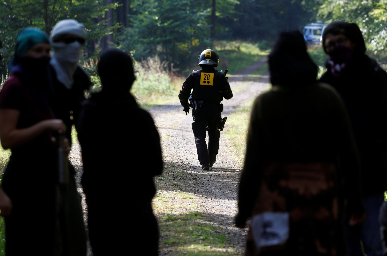 A police officer walks as the police and forest workers clear a camp at the Dannenrod forest during a protest of environmentalists against the extension of the highway Autobahn 49, in Dannenrod, Germany, Sept. 16, 2020. (Reuters Photo)